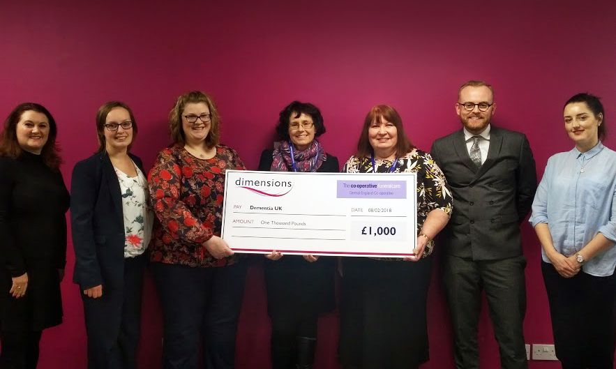 Staff from Central England Co-operative Funeralcare, Dementia UK and Dimensions at the cheque presentation
