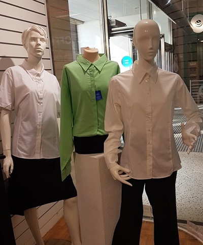 Garments on mannequins in a Salvation Army store